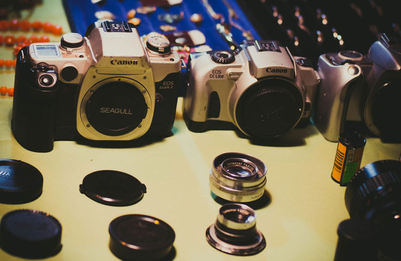 Arrangement Arts Culture And Entertainment Camera - Photographic Equipment Choice Close-up Control Equipment Focus On Foreground For Sale High Angle View Indoors  Large Group Of Objects Music No People Photography Themes Selective Focus Still Life Table Technology Variation