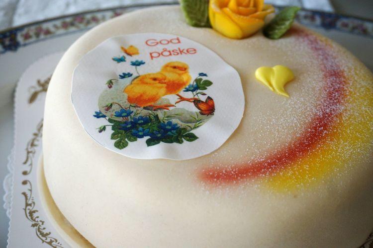High angle view of marsipan cake served on table