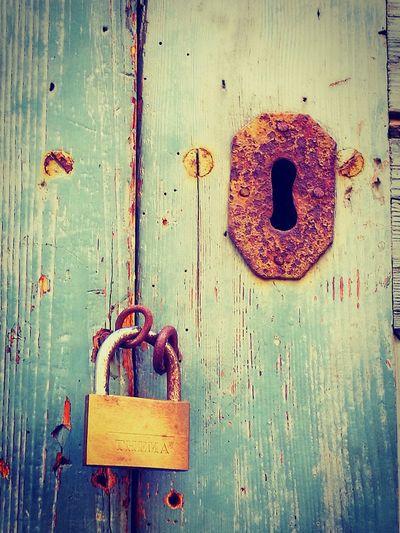 Lock And Padlock Close-up Wood - Material Metal Doors With Stories Doors With A Story Streetphotography Door With Story Street Photography Lock Door Front Door Closed Old Lock Locks Padlock New Padlock Padlocks