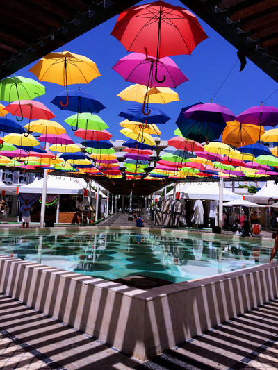 colorful umbrellas EyeEm Best Shots EyeEm Gallery EyeEmNewHere Fountain Reflection SPAIN Travel Photography Vacations Colorful Umbrellas Day Enjoying Life Eye4photography  Leisure Activity Lifestyles Multi Colored Outdoors People Shadow Sky Umbrellas Water