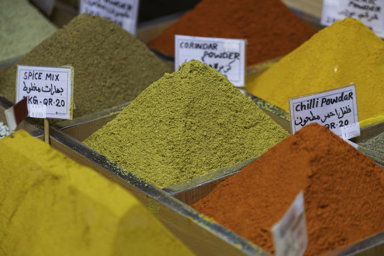 Spices in Local Market Market Spice Choice Variation Text Market Stall Retail  For Sale Ground - Culinary Food And Drink Food Price Tag Western Script Abundance Small Business No People Freshness Communication High Angle View Arrangement Retail Display Label Ijas Muhammed Photography Qatar Doha Arabic Istanbul Turkey