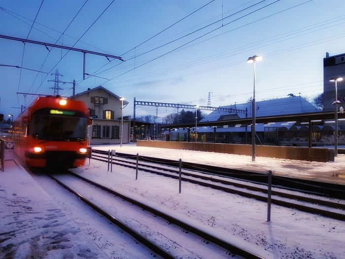 Transportation Train - Vehicle Railroad Track Rail Transportation Blue Sky Mode Of Transport Railroad Station Cable Built Structure Outdoors Public Transportation Snow Winter No People Architecture Morning