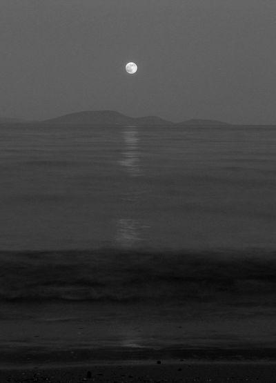 ...super moon rises over Marathon bay, Greece - Blackandwhite Supermoon 2013