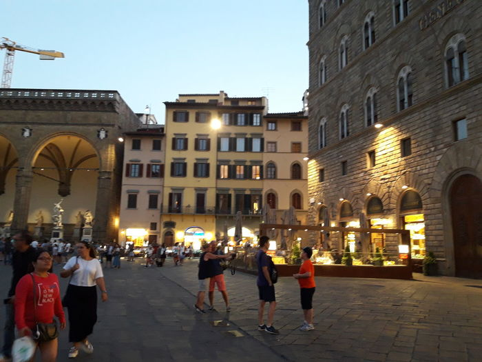 Firenze Adult Arch Architecture Building Building Exterior Built Structure City Clear Sky Dusk Group Of People Illuminated Italy Leisure Activity Lifestyles Men Nature Outdoors People Real People Sky Street Varda Walking Women