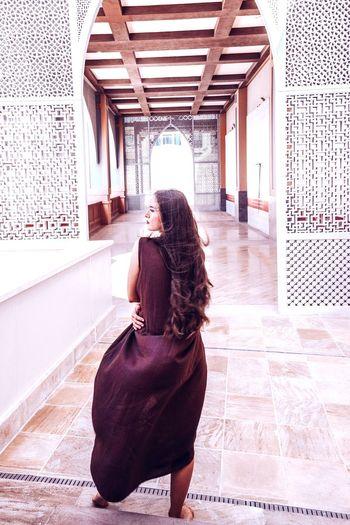 Doha walking. Arabic spirit. Arabic Style Arabic Architecture Long Hair Qatar Still Life Fashion Photography Linen Texture Doha Women Rear View Corridor Architecture Built Structure Human Back Back Palace Wavy Hair