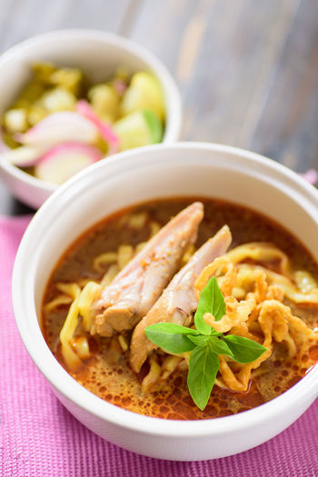 Northern Thai food (Khao soi), curry noodles soup with chicken Cuisine Curry Homemade Food Noodles Spicy Asian Food Bowl Close-up Day Delicious Focus On Foreground Food Food And Drink Freshness Healthy Eating High Angle View Indoors  No People Northern Thai Food Ready-to-eat Serving Size Soup Table Thai Food Vertical