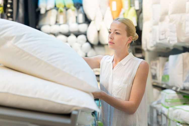 Mid adult woman standing in departmental store