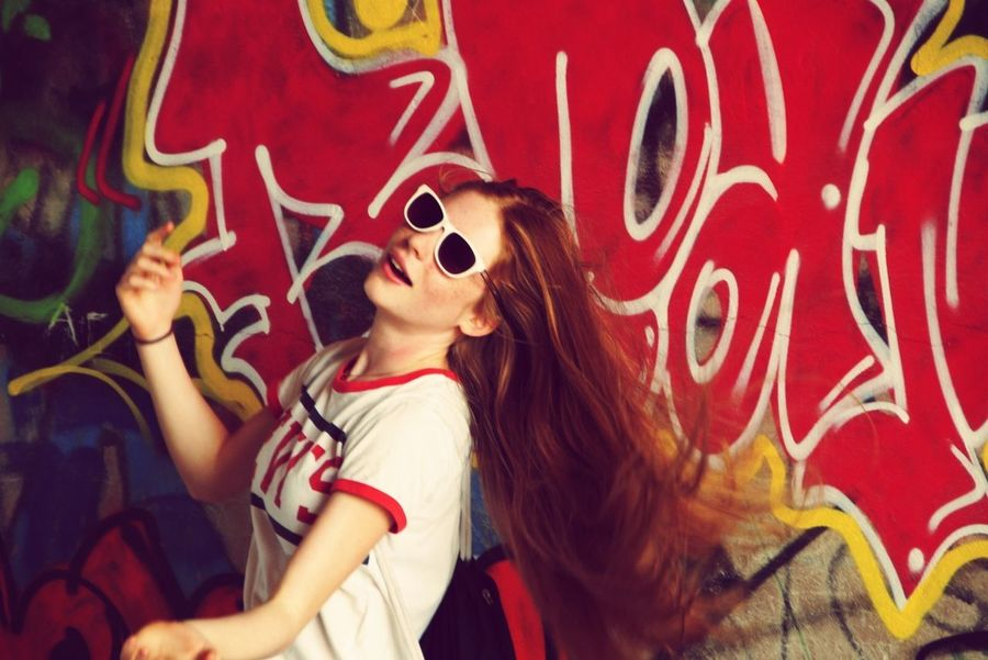 Graffiti Sunglasses Portrait Arts Culture And Entertainment Enjoyment One Person Red Outdoors Day Cheerful Smiling Summer Girl