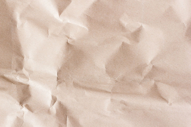 Close-up of paper on bed
