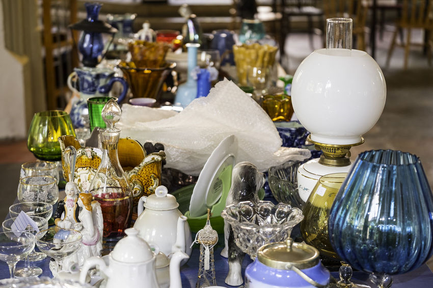 Various objects including glasses, pottery, lamps and vases. Indoor market. Market Bric à Brac Day Drinking Glass Fleamarket Indoors  No People Ornaments Plates Porcelain, Mosaic, Pieces, Broken, Design, Art, Decoration, Style, Vintage, Traditional, Creativity, Ceramic, Cracked, Table