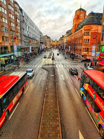 symmetric mobility. Streetphotography Basic Stockholm Cars Streetart Bus Mobility In Mega Cities Large Group Of People Real People Sky Architecture Day Built Structure Men Outdoors Lifestyles Building Exterior People #urbanana: The Urban Playground