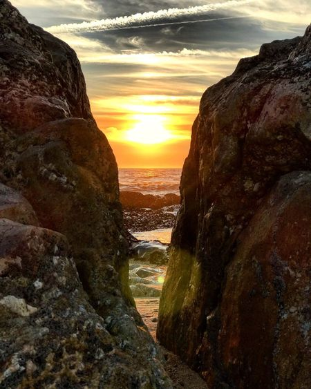 Sunset Sun Orange Color Nature Sky Tranquil Scene Tranquility Beauty In Nature Scenics Sunlight Rock - Object Outdoors No People Water Day Portugal Atlanric Ocean Senhor Da Pedra Beach Beauty In Nature History Spirituality MYheart