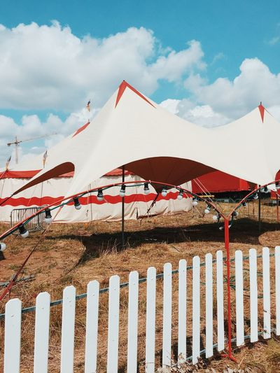 Circus Tents On Field Against Sky