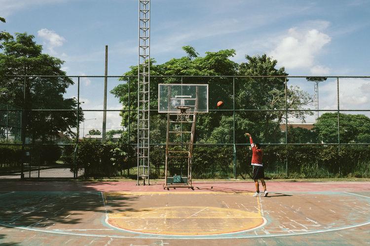 Man playing basketball on court