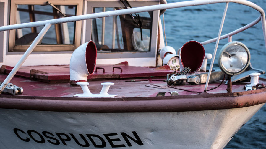 Nautical Vessel Transportation Mode Of Transportation Water Day Moored Text No People Sea Rope Nature Close-up Western Script Outdoors Focus On Foreground Metal Wood - Material Travel Communication Sailboat Nautical Equipment Passenger Craft