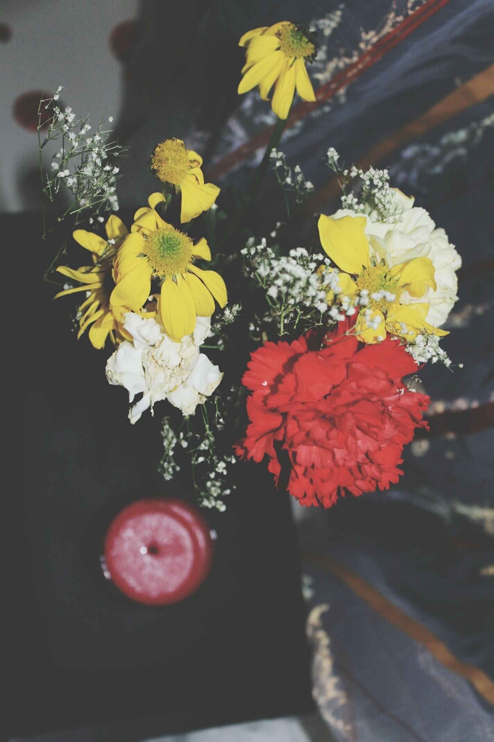 flower, petal, freshness, fragility, yellow, flower head, close-up, beauty in nature, growth, nature, focus on foreground, plant, blooming, high angle view, in bloom, indoors, blossom, no people, selective focus, red