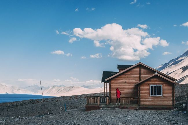 On the shore of Pangong lake, which shares its territory with India and China Mountain Camping Camp Wooden Wooden Hut The Traveler - 2018 EyeEm Awards Sea Beach House Sky Architecture Building Exterior Built Structure Cloud - Sky Beach Hut Stilt House Myanmar Culture Horizon Over Water Wave Seascape Stilt Hut Shore Calm Lifeguard Hut Hooded Beach Chair Coast Thatched Roof Coastline Groyne