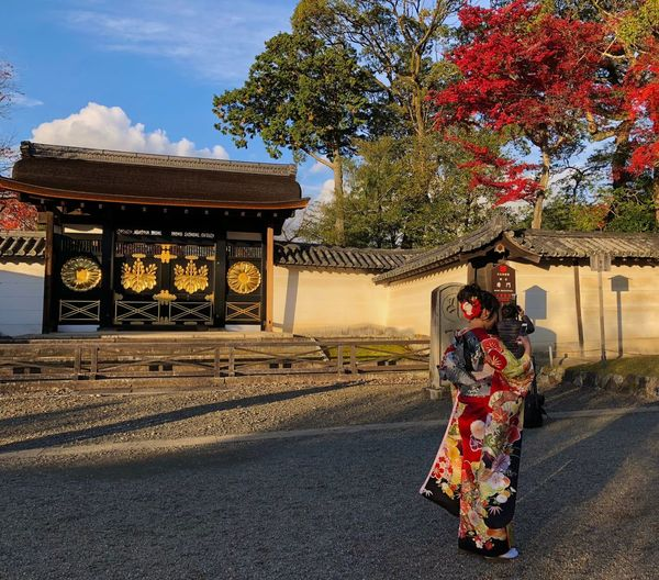 Maple Tree Woman Rear View Autum Trees Japanese Architecture Temple Kimono Geisha Architecture Building Exterior Built Structure Real People Tree Full Length Outdoors Young Adult Adult Day One Person Sky Adults Only People
