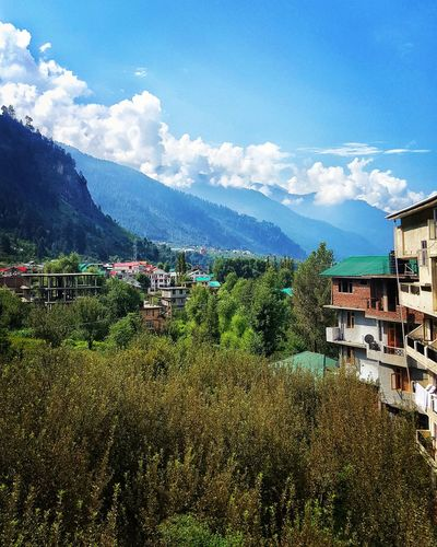 Scenic view of manali and mountains against sky