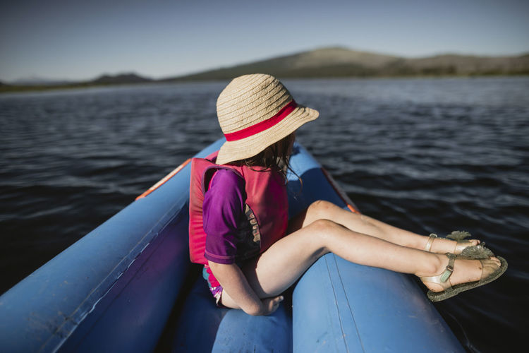 Midsection of woman in lake against sky