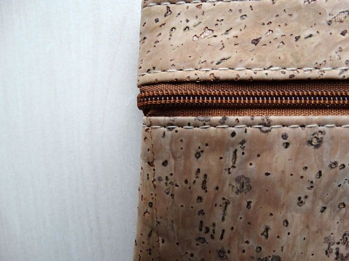 Zip. Background Backgrounds White Background Brown Zip Up Studio Shot Table Cork Textures and Surfaces Textures Texture Textured  Pattern Bag Wallet Purse Zipper Zip No People Close-up Indoors  Day