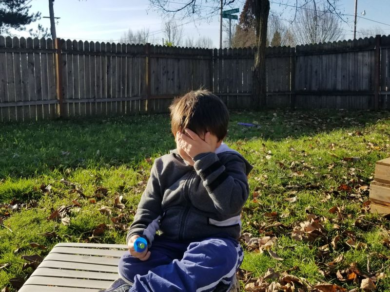 My Son, after my bad joke... Face Palm One Person People Childhood Grass Leisure Activity Day