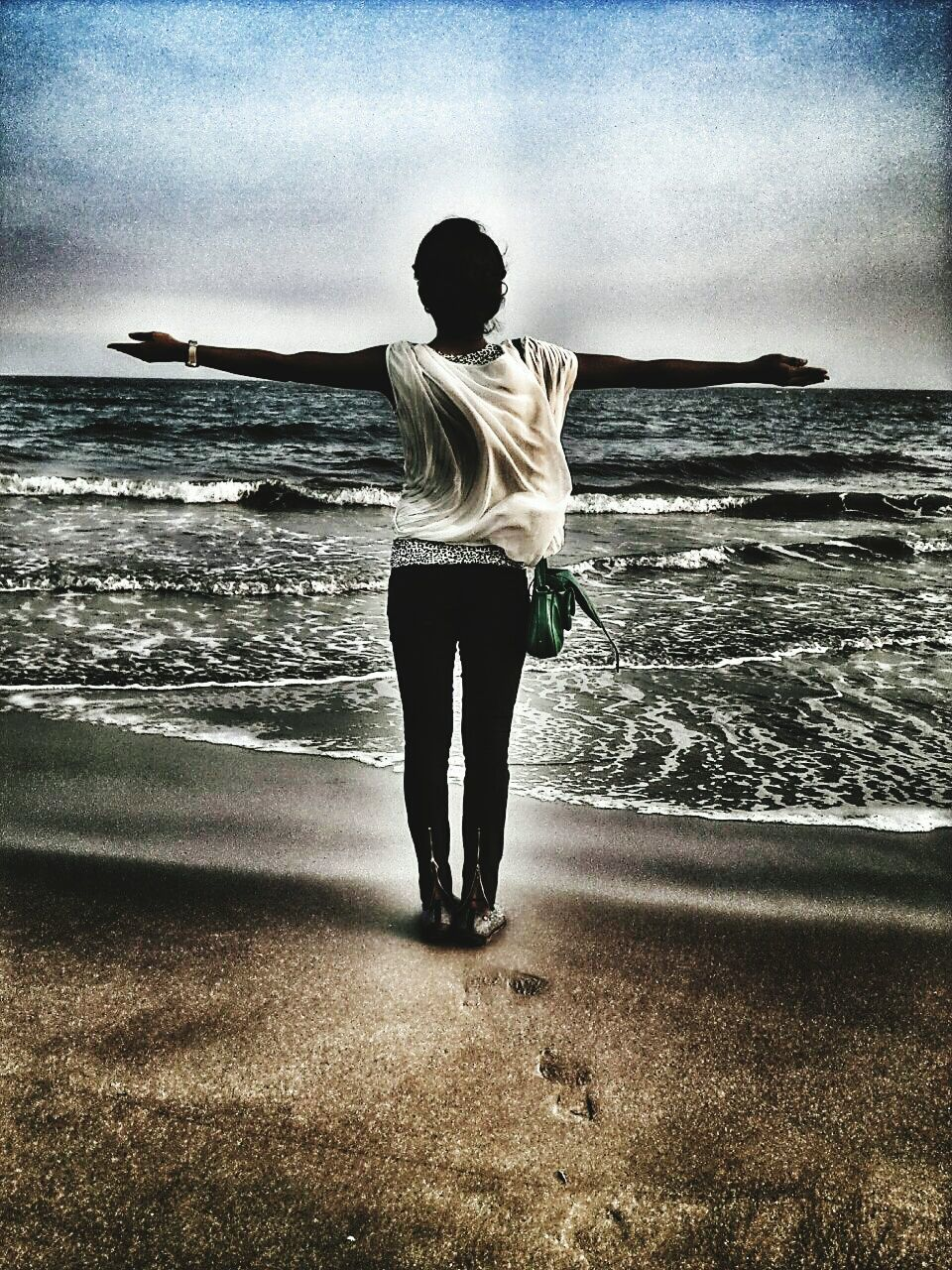 sea, real people, full length, horizon over water, water, one person, beach, leisure activity, standing, lifestyles, sky, rear view, nature, outdoors, young adult, day, young women, balance, tranquility, tranquil scene, scenics, beauty in nature, women, cloud - sky, sand, wave, energetic, people