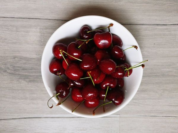 Cherry bowl on wooden background Red White Gray Background Healthy Eating Healthy Food Table Top View Bowl Food Light And Shadow Pomegranate Directly Above Cherry Fruit Bowl