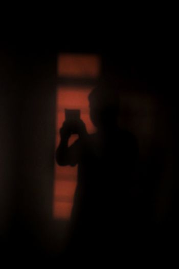 Shadow of hand on silhouette person