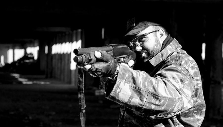 Man Shooting A Rifle