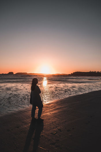 Woman Walking At Beach During Sunset