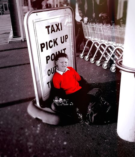 Waiting Taxi Boy Taxi Pick Up Red Jumper Shopping Supermarket Slumped