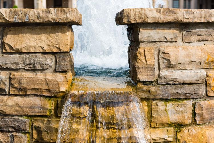 Stone Wall Against Fountain