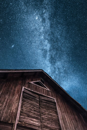 """Up"". I came across a barn that seemed to want to remind us where we came from in the first place. Architecture Astronomy Awe Beauty In Nature Blue Built Structure Clear Sky Constellation Galaxy Low Angle View Milky Way Nature Night No People Outdoors Red Sky Småland Space Space And Astronomy Star - Space Star Field Sweden Wood - Material"