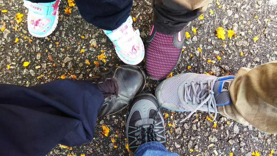 family Low Section Men Standing Human Leg High Angle View Shoe Directly Above Close-up Footwear Human Feet Personal Perspective Canvas Shoe Legs Crossed At Ankle Feet Human Foot Things That Go Together Shoelace Sandal