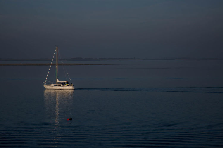 Artistic Photo Beauty In Nature Boat Calm Journey Nature Ocean Outdoors Sailboat Sailing Sea Seascape Sky Water Waterfront