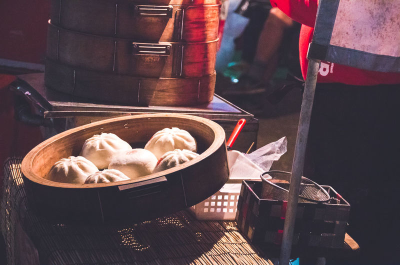 High angle view of dumplings in steamer at market stall