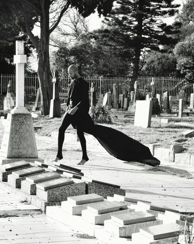 Young man in a cemetery