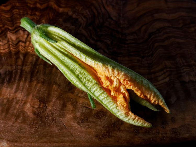 Courgette Flower Close-up Cucumber Day Focus On Foreground Food Food And Drink Freshness Green Color Healthy Eating High Angle View Indoors  No People Raw Food Single Object Still Life Studio Shot Table Vegetable Wellbeing Wood - Material Wood Grain