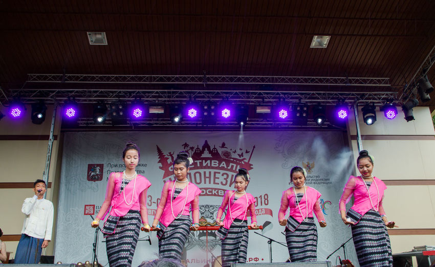 Indonesian national dance of girls Adolescence  Arts Culture And Entertainment Boys Dancing Enjoyment Fun Group Group Of People Happiness Illuminated Indoors  Leisure Activity Men People Performance Real People Smiling Stage Standing Teenage Boys Three Quarter Length Togetherness Women