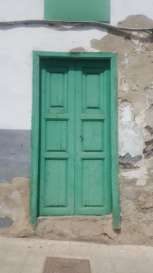 Green Color Door Outdoors Built Structure Architecture No People Building Exterior Closed Door To Anywhere