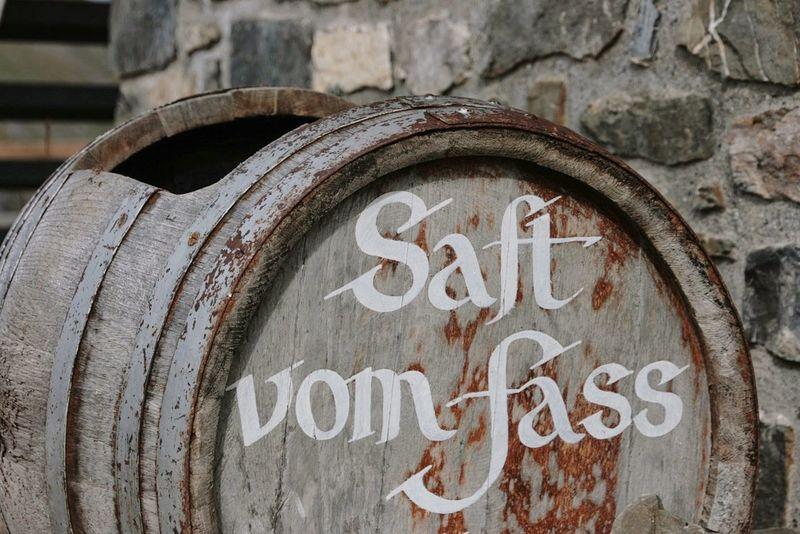 Fass Juice Saft  Trog Brick Wall Schweiz Switzerland Freshness Fresh Fresh Juice Drinking Arosa Barrel Barrels Canister Woodbarrel Text No People Close-up Communication Day Outdoors