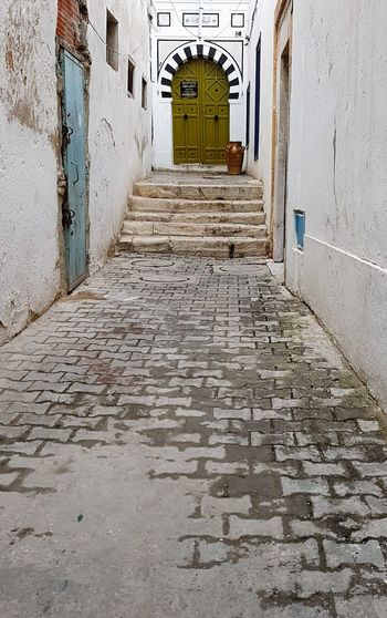 Door Architecture Building Exterior Built Structure Passageway Entryway Passage The Way Forward Pathway Stairway Corridor Hallway Lane Diminishing Perspective Destinations Arched Treelined Archway Closed Door Walkway Entrance Stairs Narrow Long Empty Road Entry Colonnade