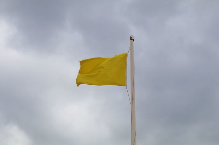 Yellow Flag Beachphotography Caution EyeEm Best Shots EyeEmBestPics Flag Eye4photography  Gloomy Day Minimal Minimalism Beach Minimalobsession Sky And Clouds Wind Blowing  Skyporn Warning Sign Seaside Close-up Detail Clouds From My Point Of View EyeEm EyeEm Gallery Taking Photos Portugal