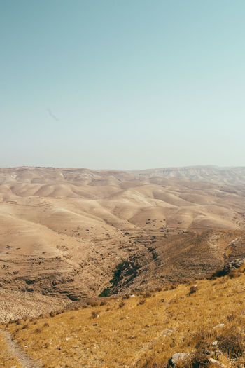 Judaean Desert Sky Landscape Environment Tranquil Scene Scenics - Nature Tranquility Beauty In Nature Clear Sky Non-urban Scene Copy Space Nature No People Day Land Mountain Blue Remote Desert Idyllic Arid Climate Outdoors Climate Rolling Landscape