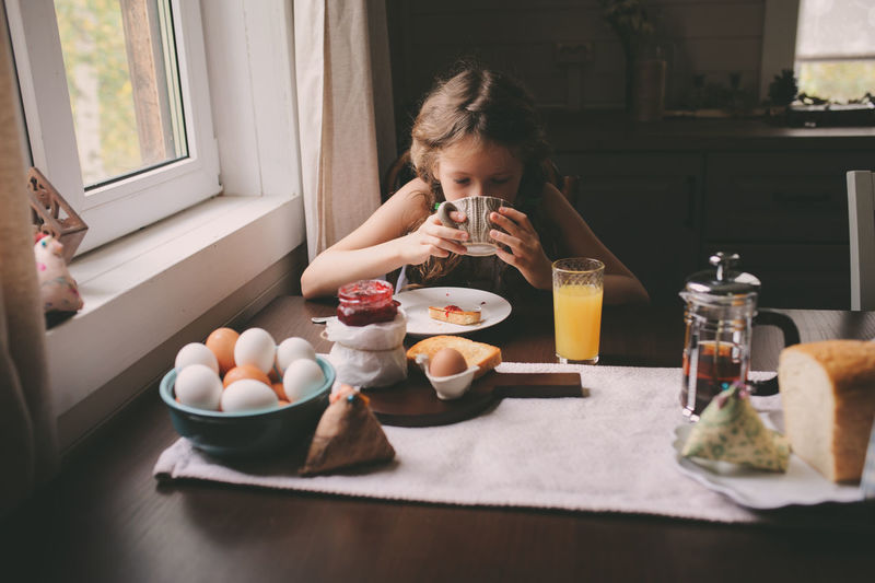 Girl Having Breakfast At Home