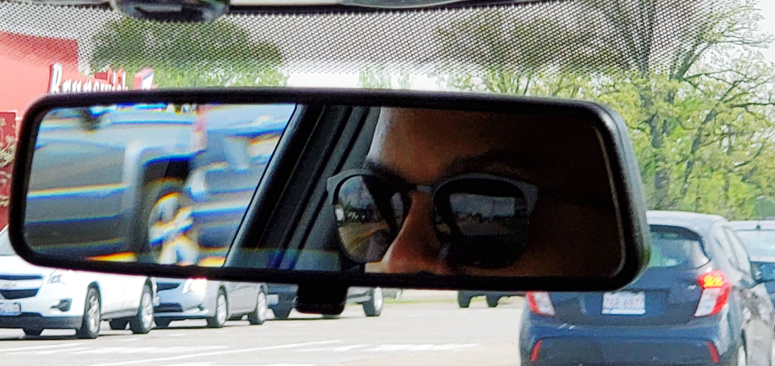 mode of transportation, transportation, car, motor vehicle, land vehicle, glass - material, reflection, rear-view mirror, one person, close-up, side-view mirror, real people, mirror, photography themes, technology, communication, day, travel, transparent, driving, outdoors, road trip