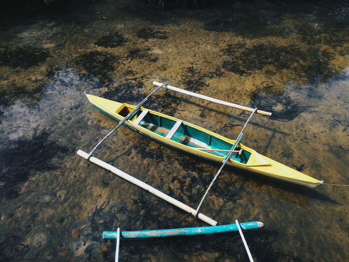 High angle view of outrigger canoe moored at sea