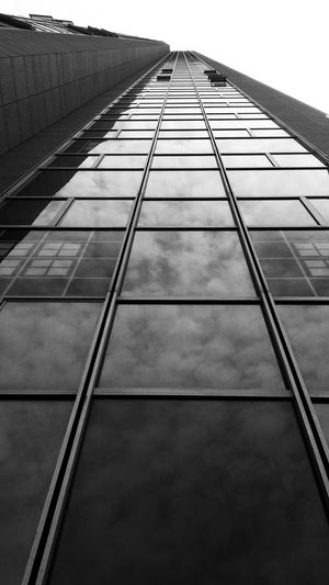 The tallest building in Israel. Had to lay on the floor to take this one. Building Reflection Architecture Skyscraper Moshe Aviv Black And White Black And White Photography Height Street Photography Streetphoto_bw Windows Looking Up Sky Reflection Ramatgan Israel