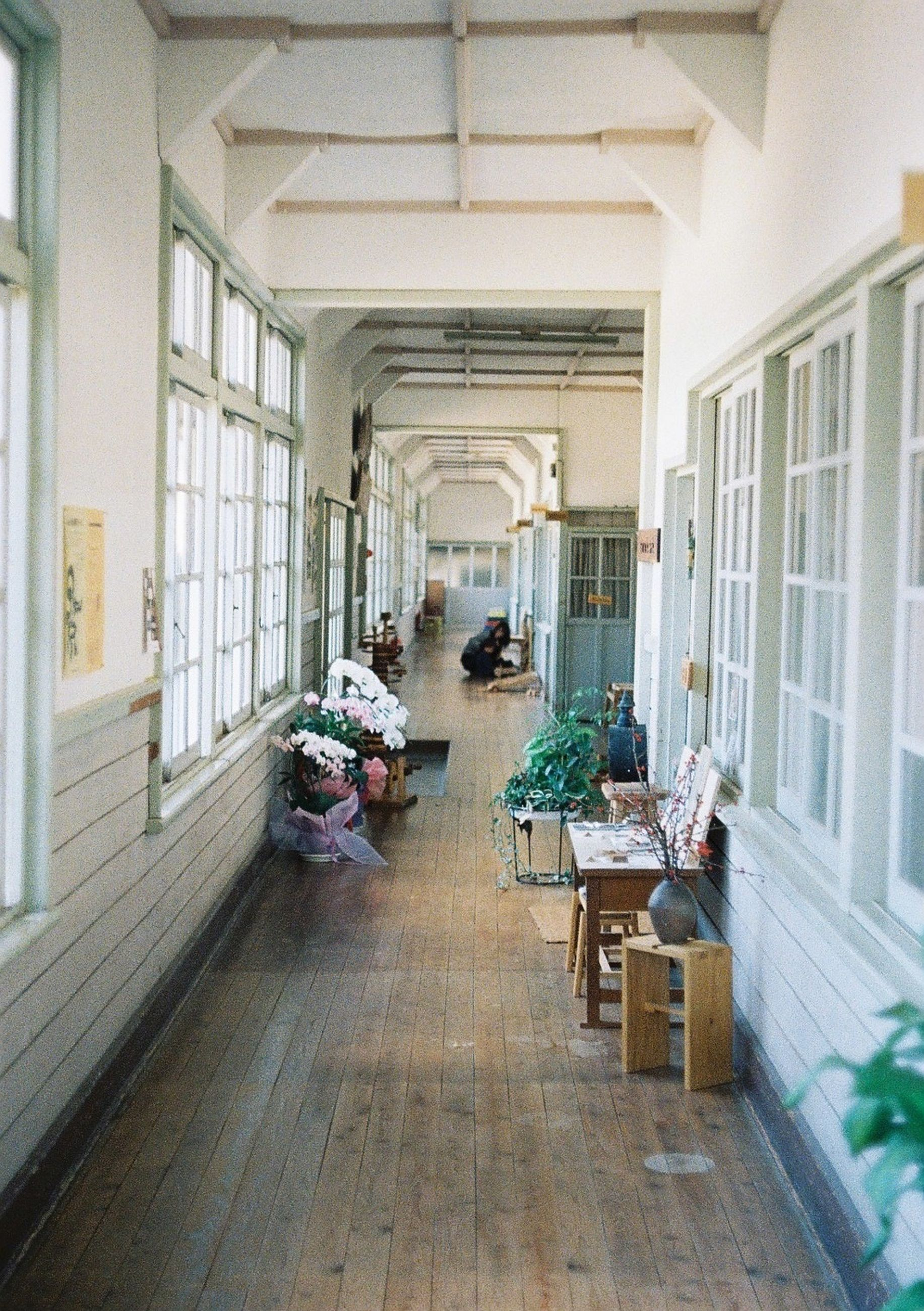 architecture, built structure, indoors, building exterior, the way forward, empty, chair, table, incidental people, day, city, absence, narrow, building, potted plant, corridor, bench, in a row, diminishing perspective, window